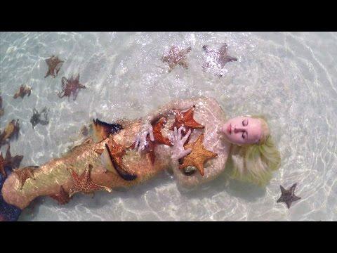 Mermaid Melissa with real sea stars on Starfish Island